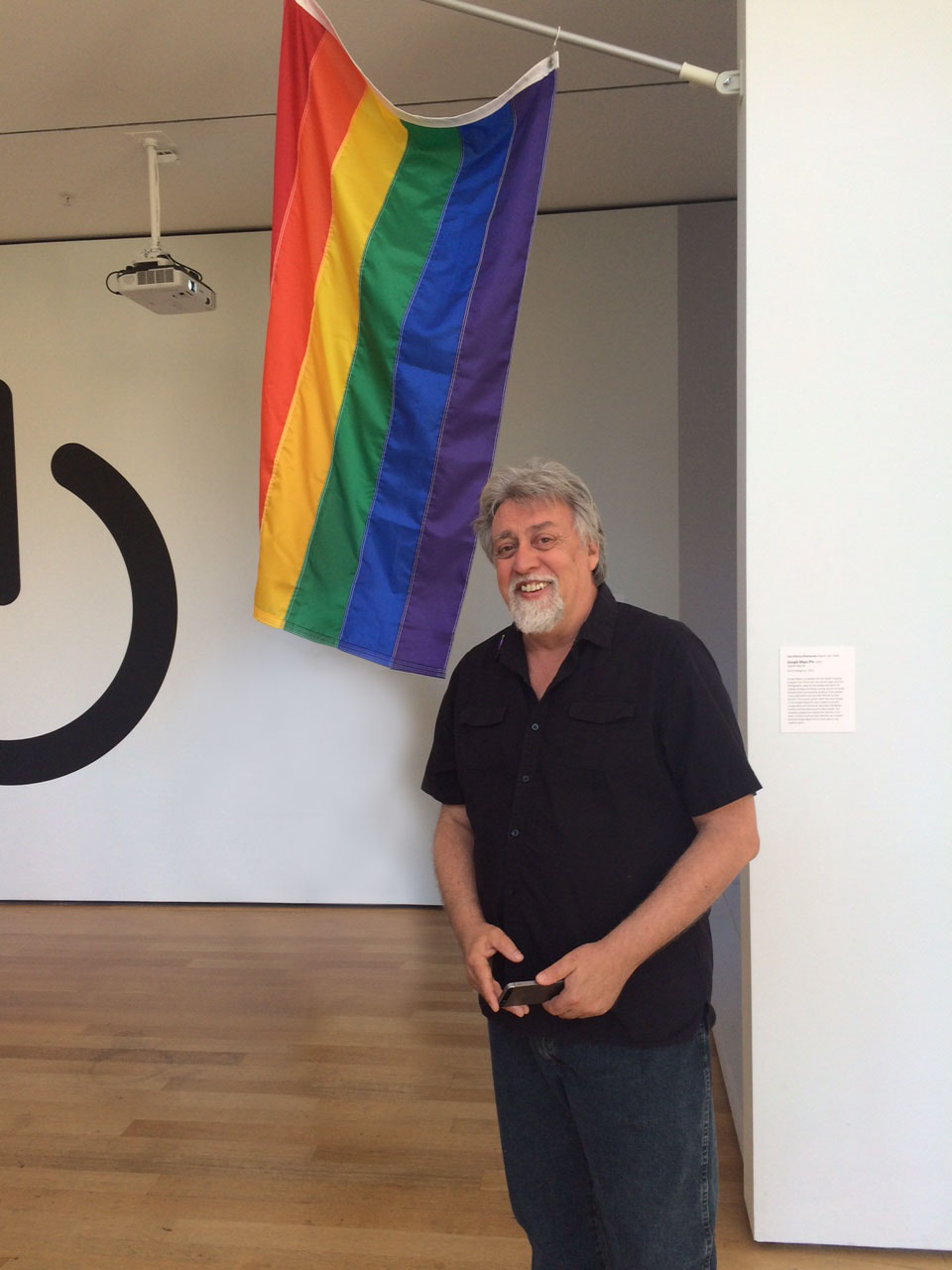 Baker with the Rainbow Flag at the Museum of Modern Art, 2015