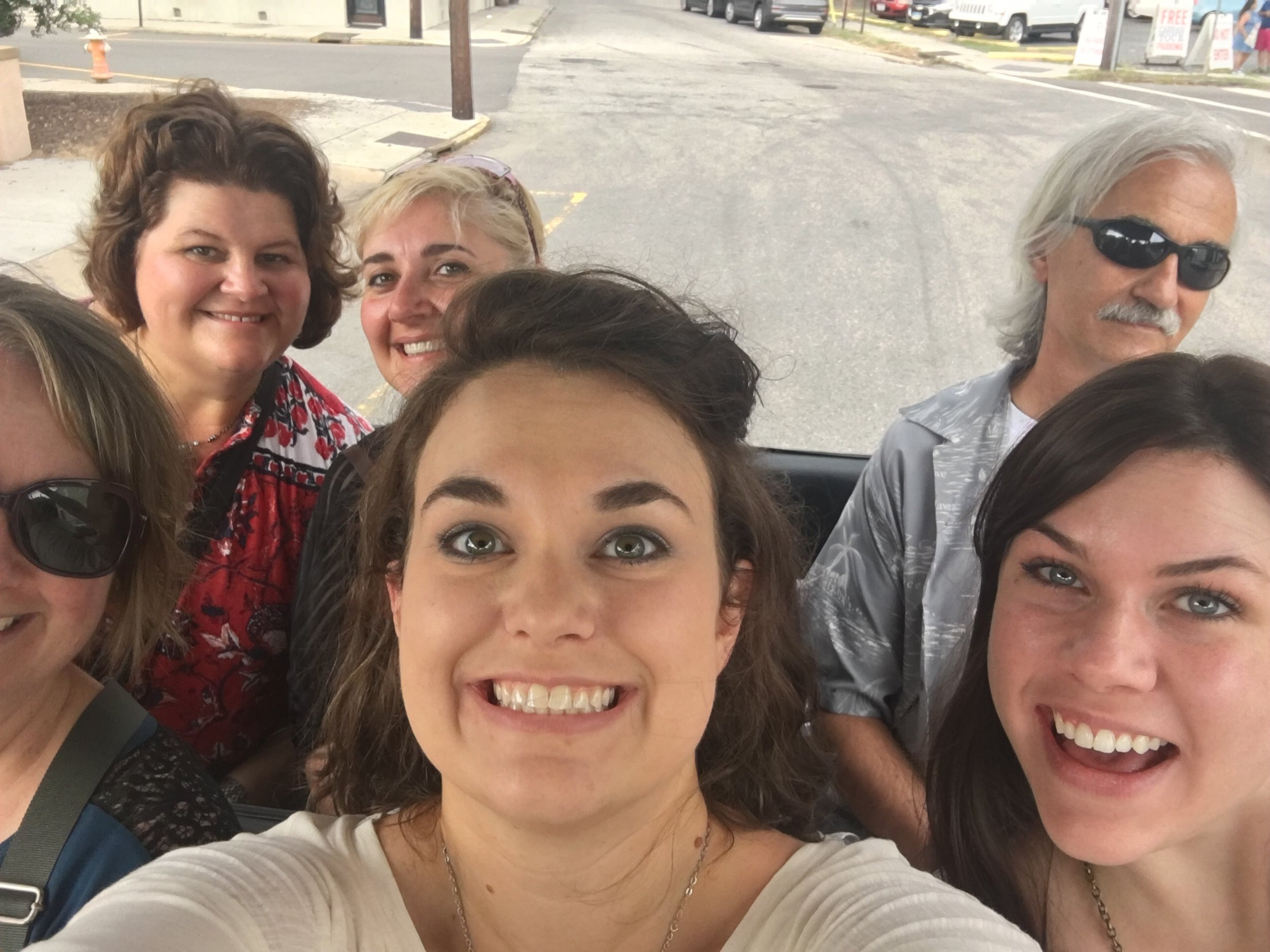 Riding a horse carriage together through downtown Charleston. Where was my selfie stick?