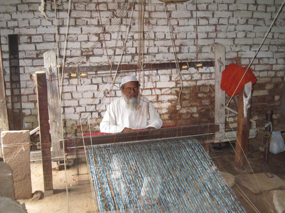 Artisan, Karimuddin, at the handloom in Varanasi