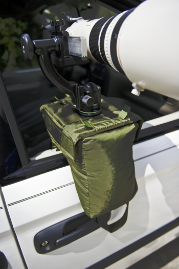 The V2 Molar Bean Bag™ and V2 Plate™ are mounted on a car door with a 500mm lens. A ball head with a Wimberley Sidekick is mounted on the V2 Plate™