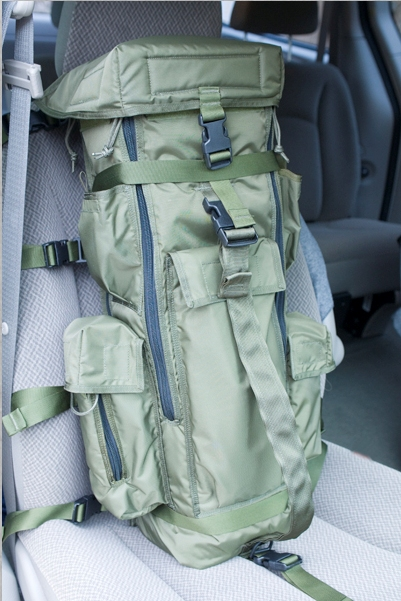 The Big Lens Bag™ is secured in the vehicle using a number of straps