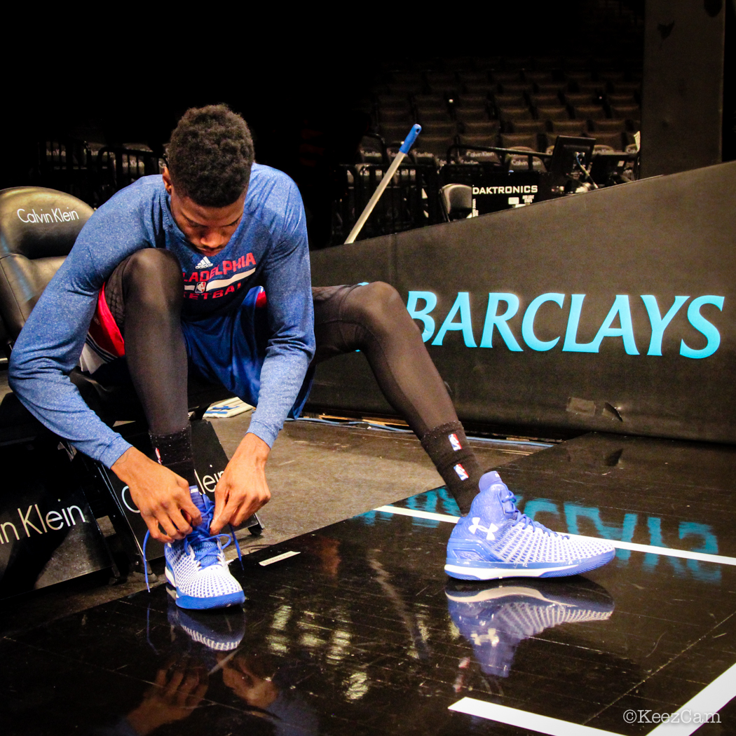 Nerlens Noel lacing up the game kicks in Brooklyn.