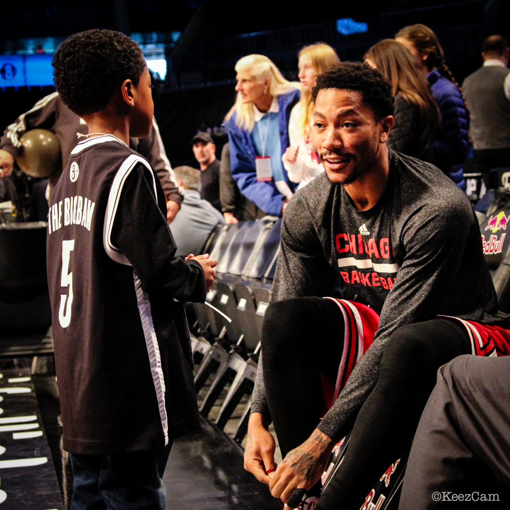Derrick Rose and his new friend in Brooklyn