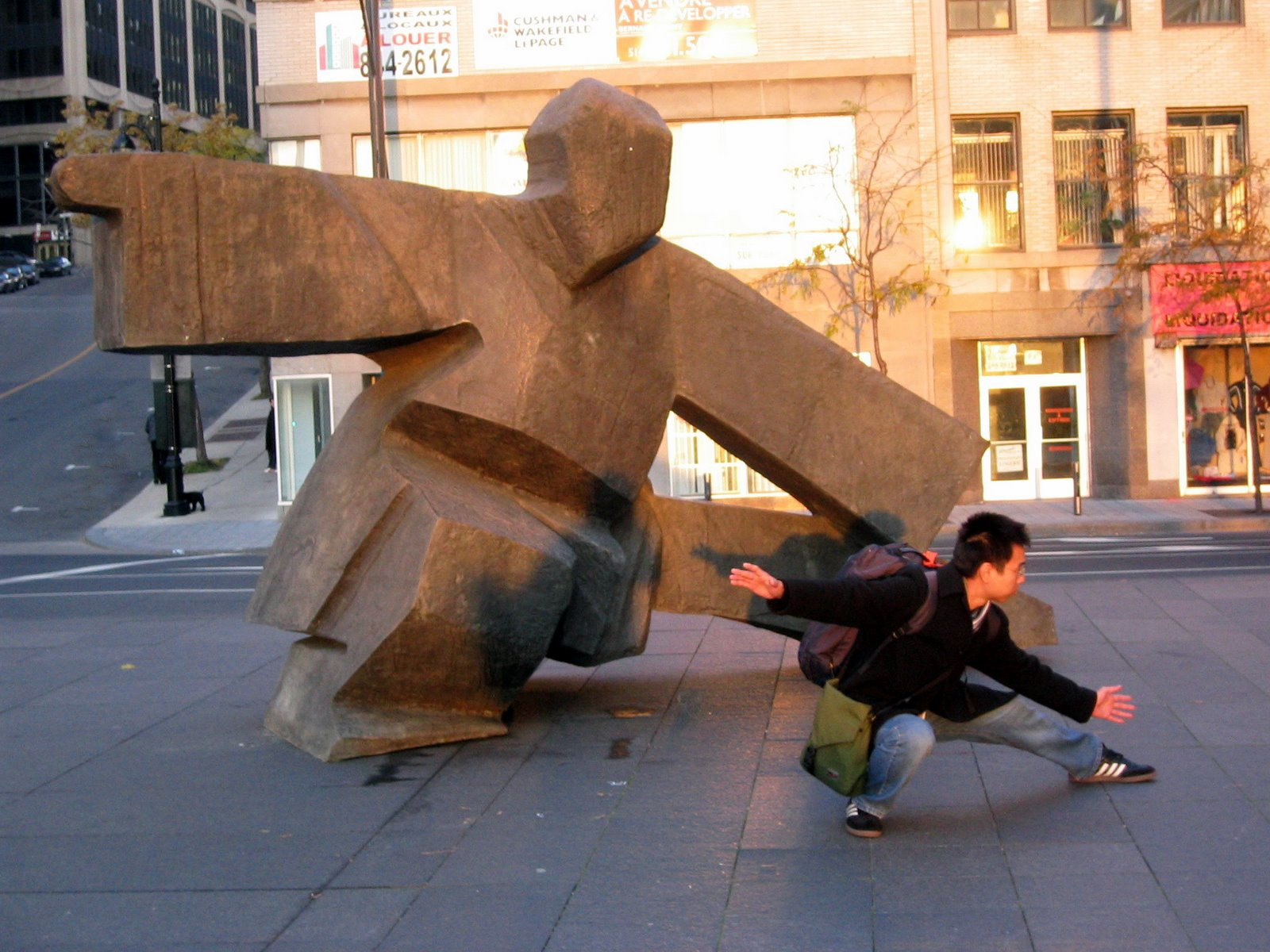 In Montreal they have a giant statue performing Taichi. I'm at the right, life imitating art imitating life.