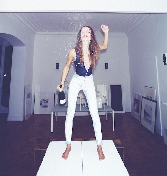 girl_standing_on_table