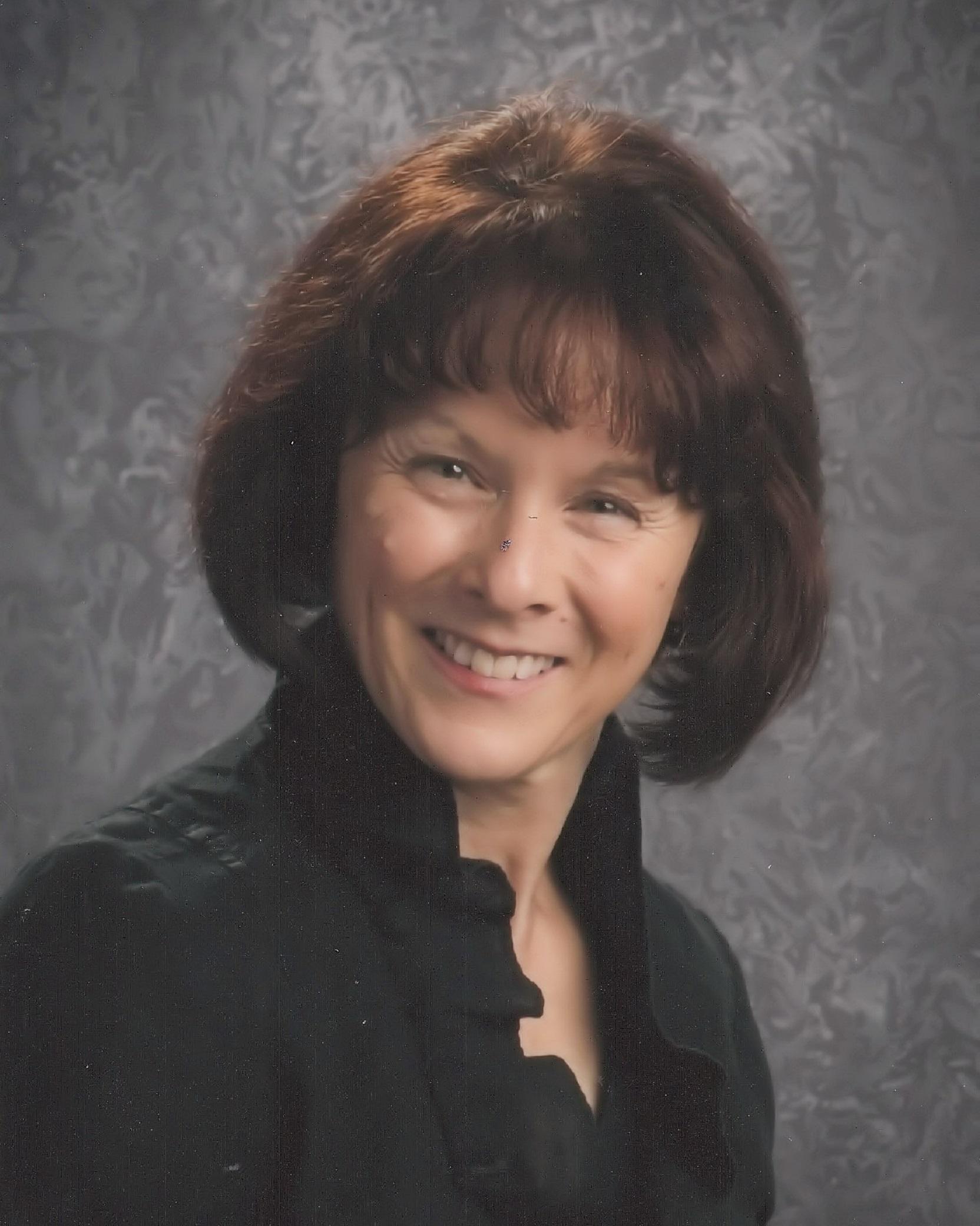 Laurie Dehmlow  Director of Alleluia & Caroler Choirs
