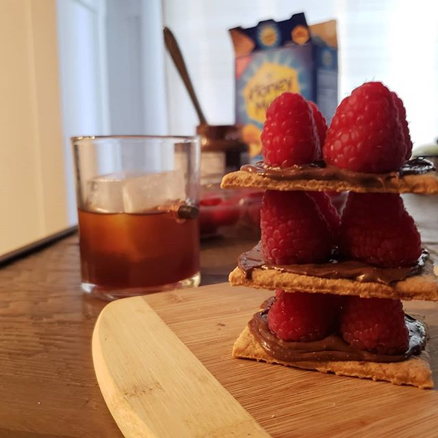 Adult snacks are the best snacks.  #thirtyflirtyandfabulous #grahamcrackers #nutella #raspberries #whiskey #adulting