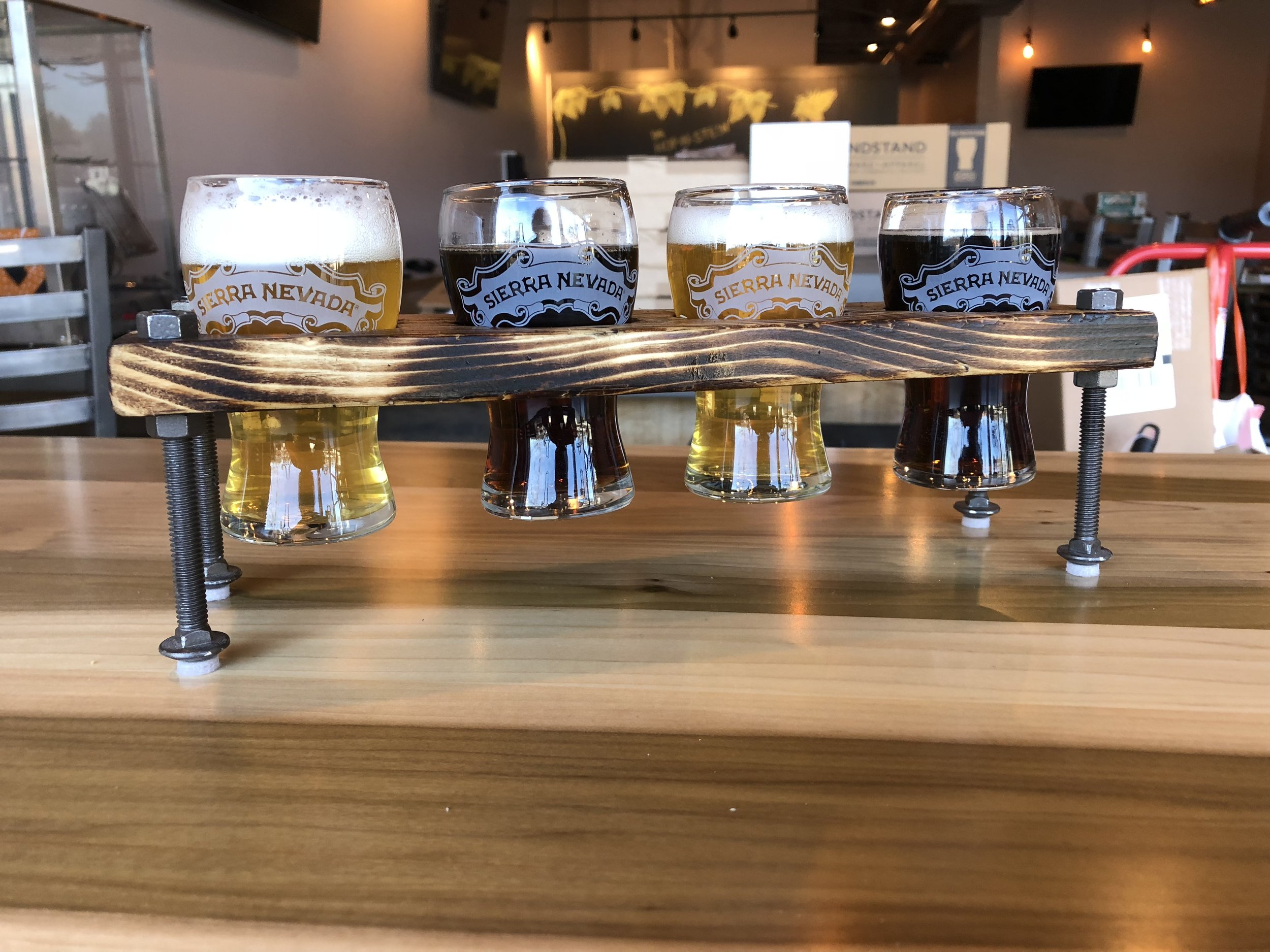 Beer flights will be served in Craftcentric's custom flight boards.