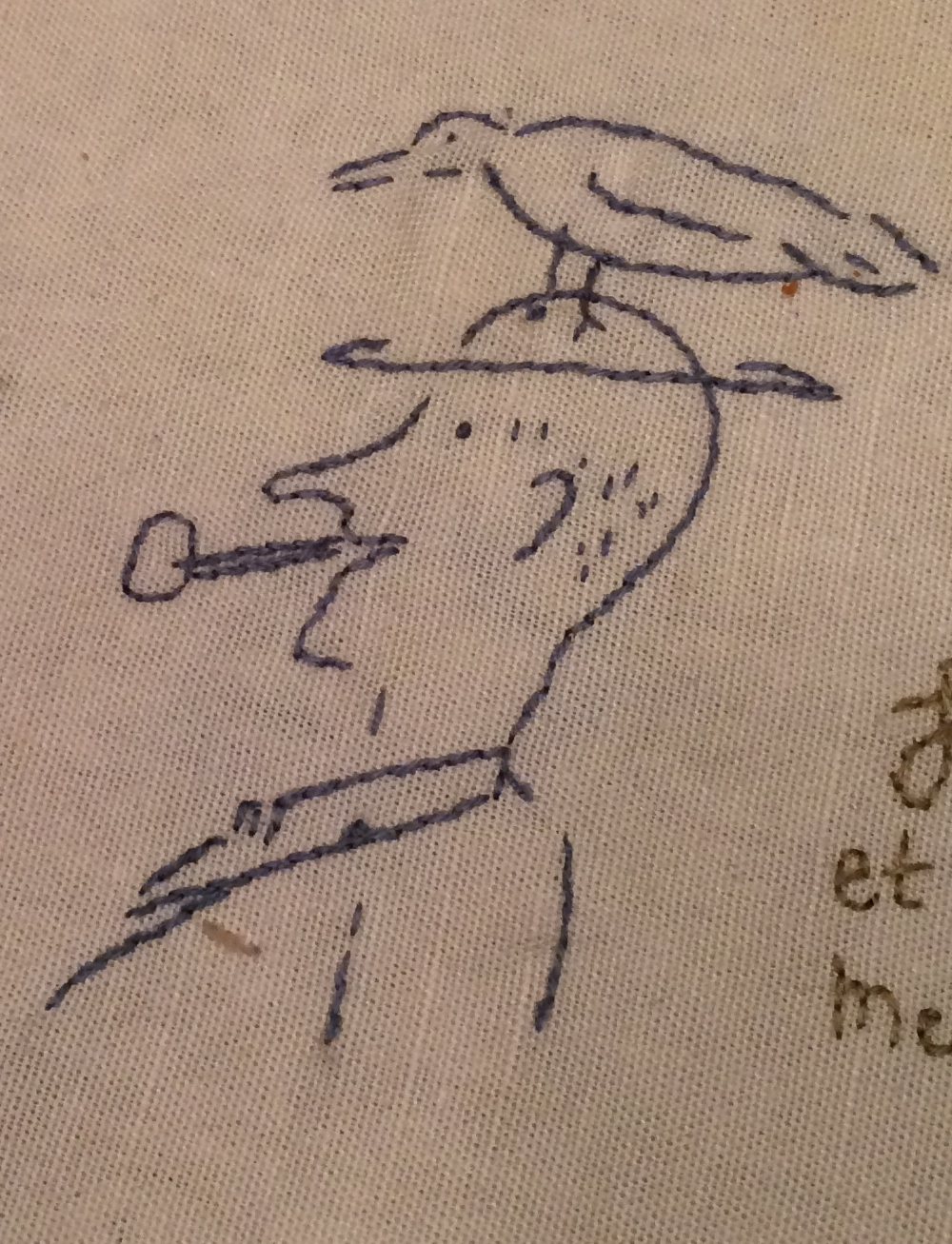 While my dad mostly drew on the beach, he drew this on my sister-in-law's famous tablecloth filled with embroidered signatures of guests.