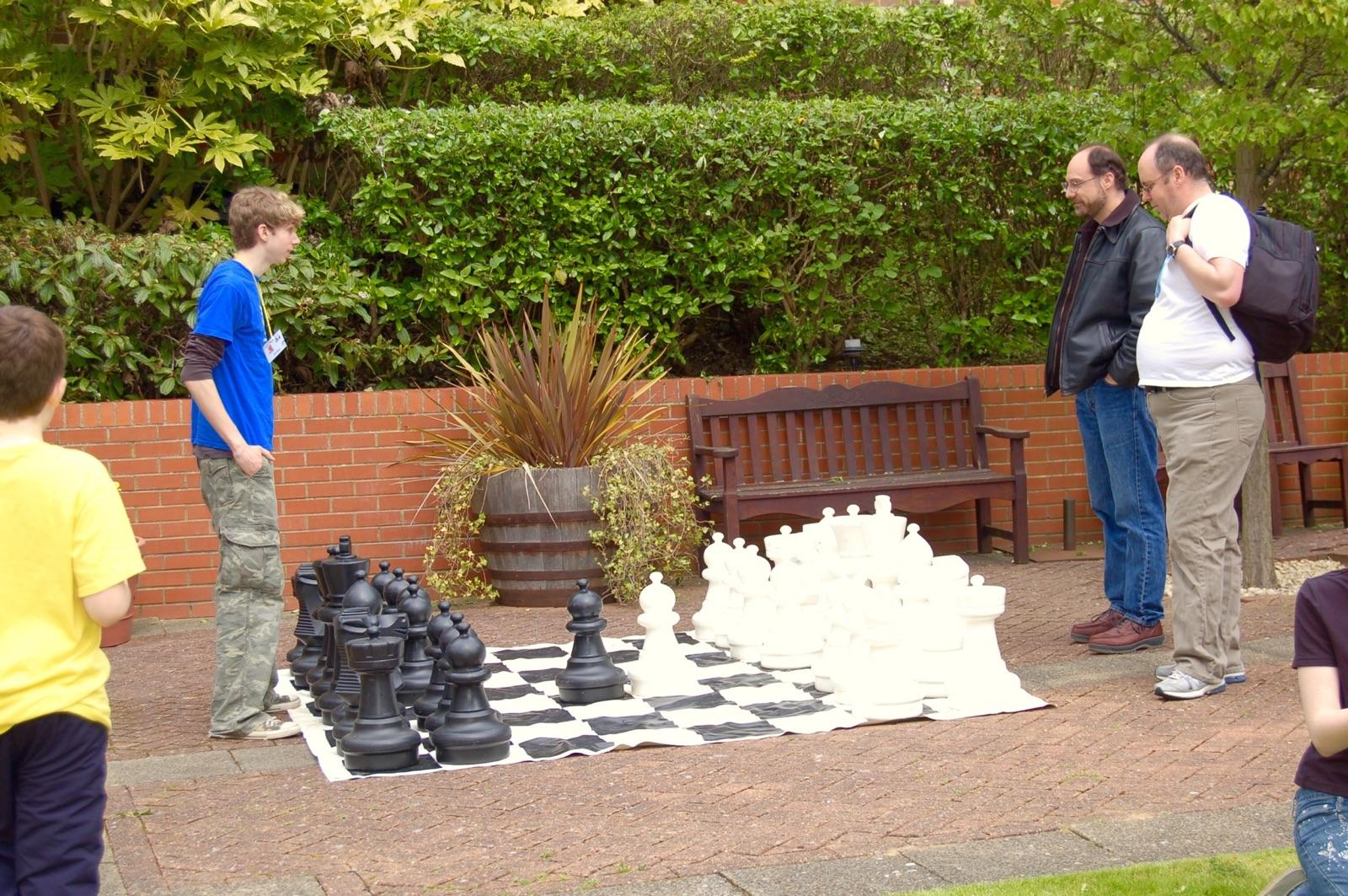 Pictured, my father (in the black jacket) and I once played an oversized game in England. He's an engineer and I'm not, so my goal in the game was usually to delay the inevitable.