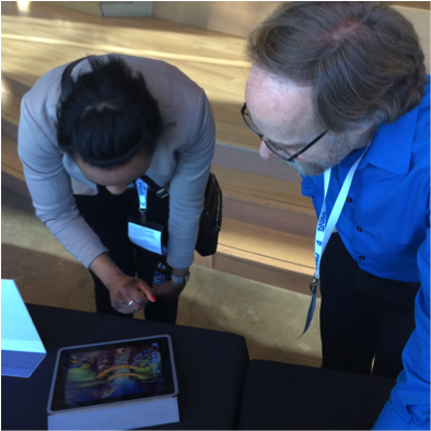 Scot Osterweil, at right, showing off  Zoombinis  to a fan.