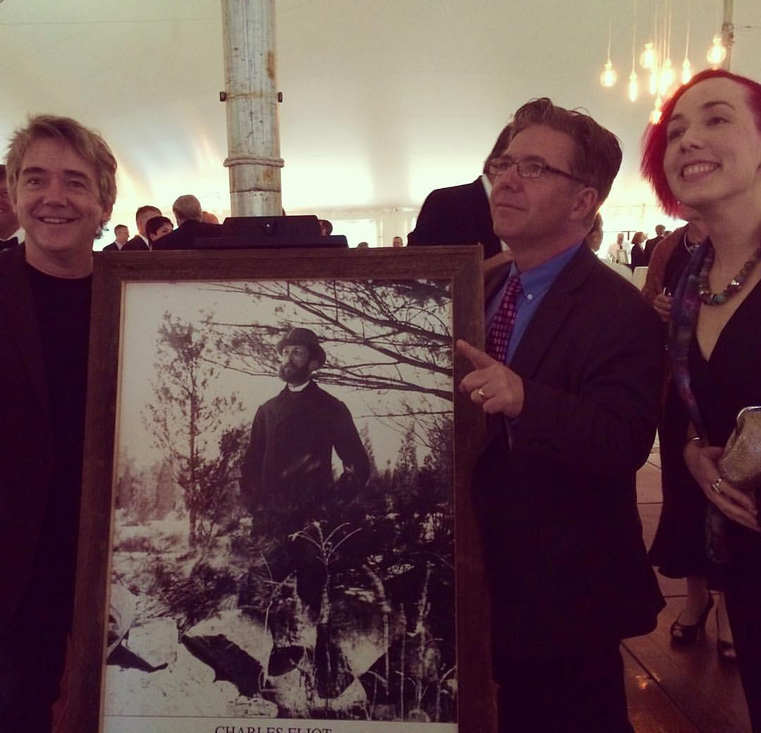 FableVision's Peter H. Reynolds, Paul Reynolds, and Julia Young pose with a portrait of Trustees founder Charles Eliot.