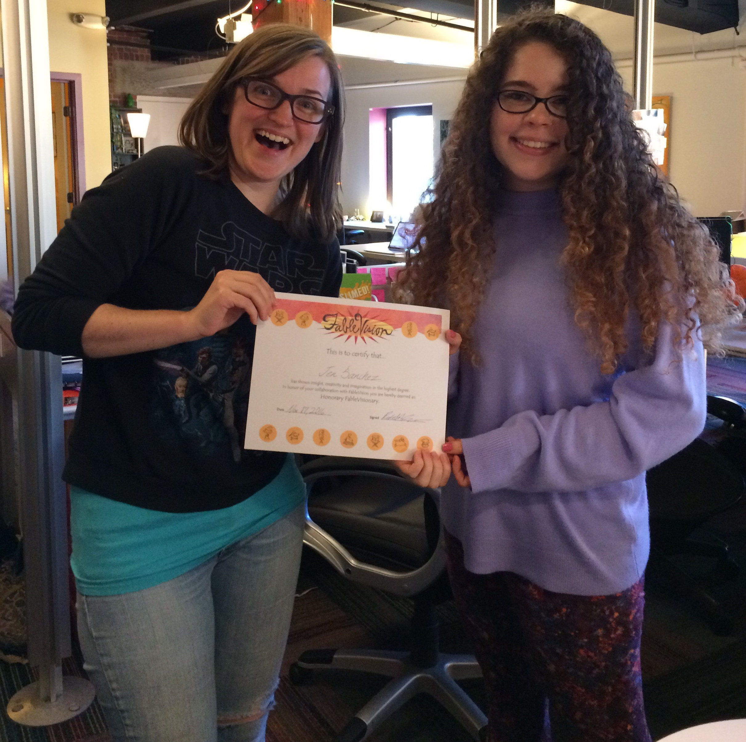 FableVision's Hannah O'Neal awarding Jen with an honorary FableVisionary award.