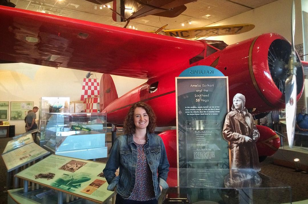 Sarah with Amelia Earhart's Lockheed Vega at the National Air and Space Museum in Washington, DC