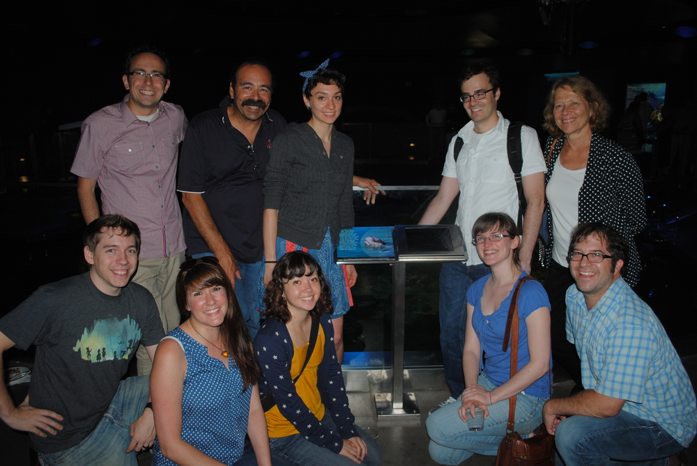 The FableVision team pictured alongside the Giant Ocean Tank's Fish ID App