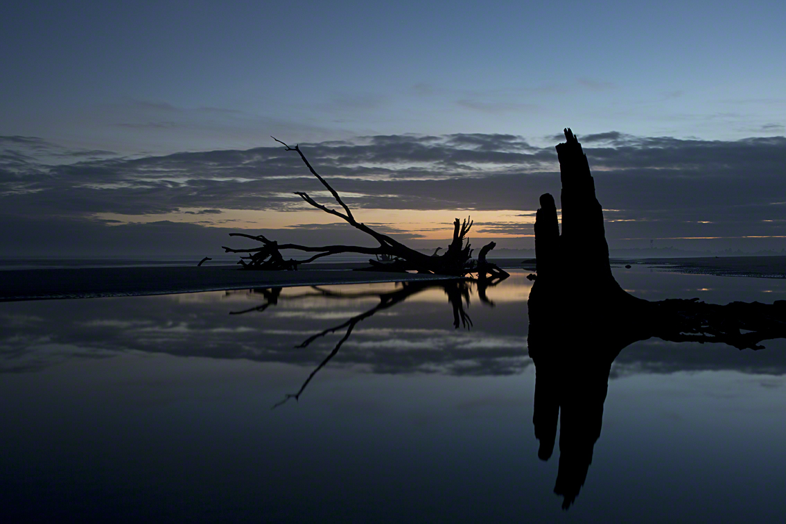sunset reflected in a tidal pool