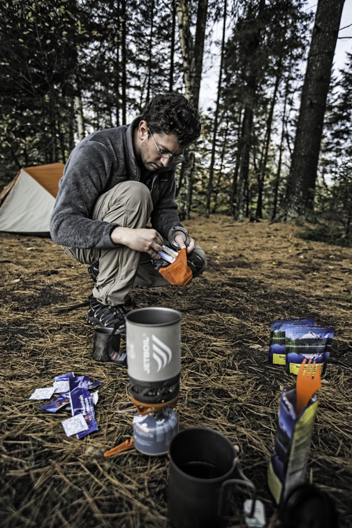 frank prepping breakfast on day 3 of our epic paddle. the rain began just before we were able to load the boats