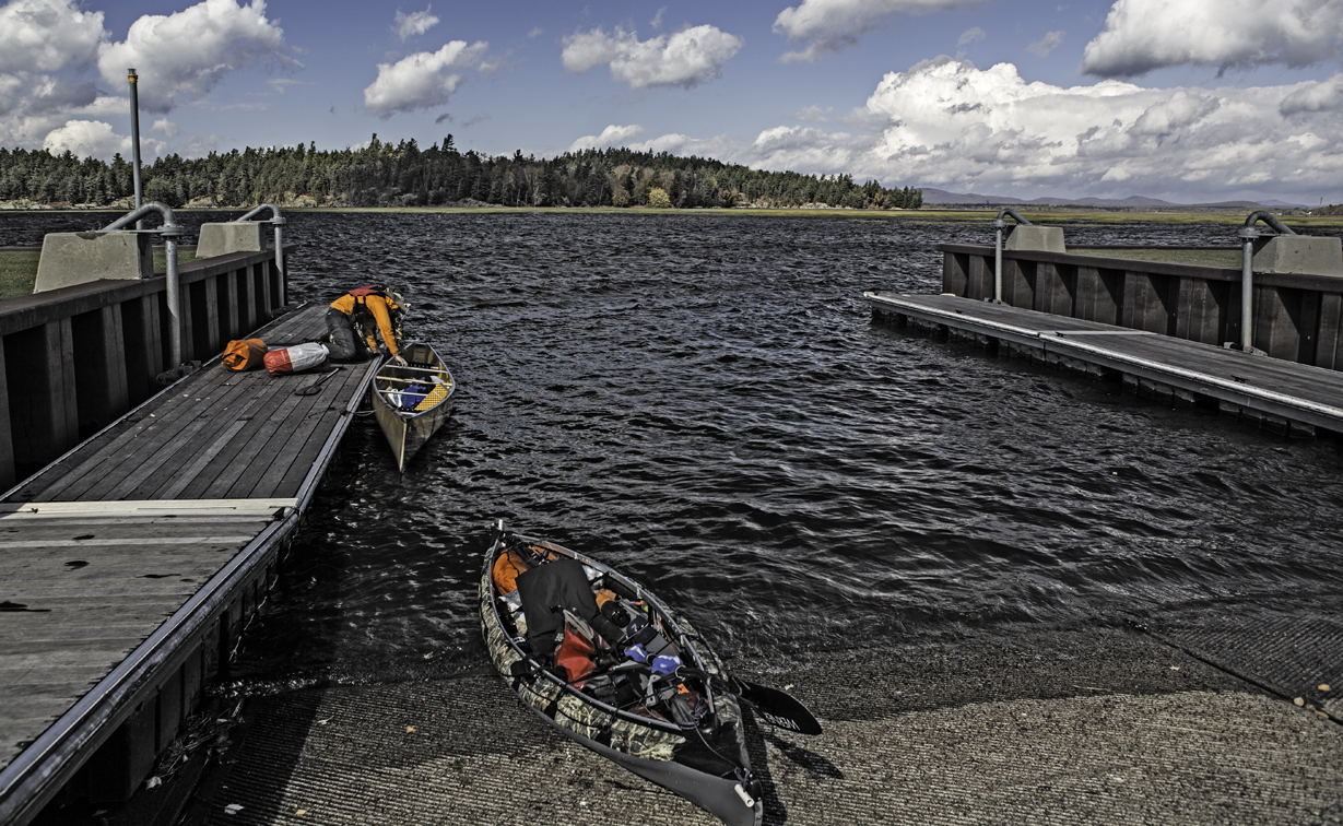 unloading the gear at the landing after a brutally windy paddle
