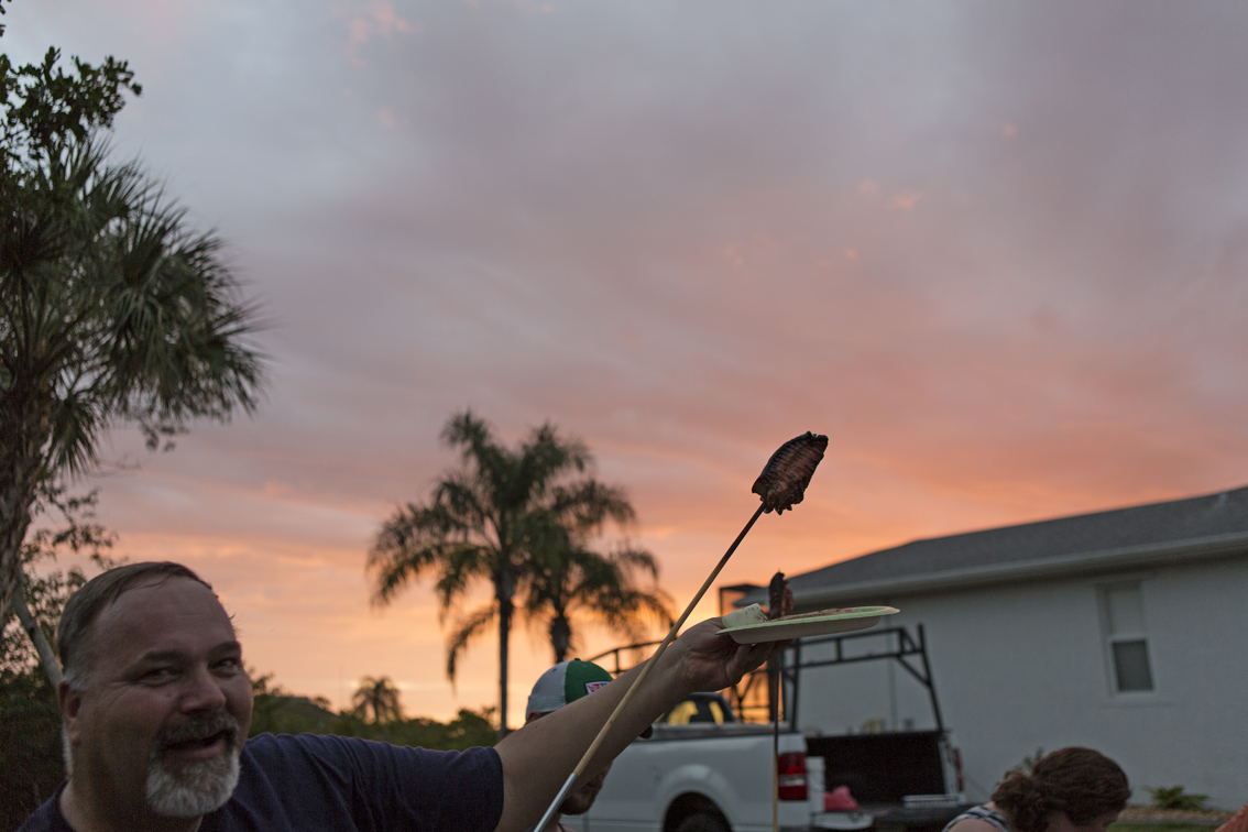 Uncle David proudly displaying his masterpiece with the sunset.