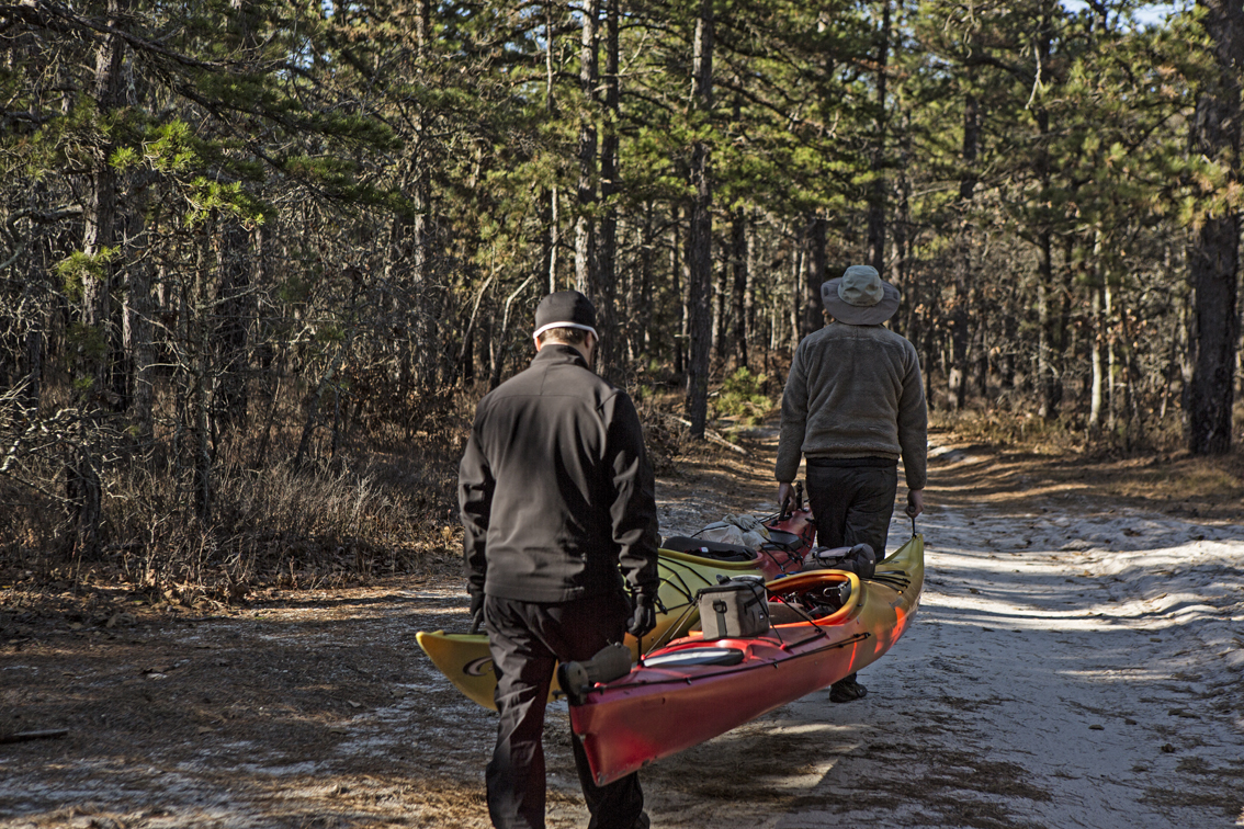 Frank and Loren doing the hard work.  We quickly decided this sucked, so I experimented with different ways of dragging the boats on the soft sandy roads, and came up with a good solution that made everyone happy, and reduced our effort to portage considerably.