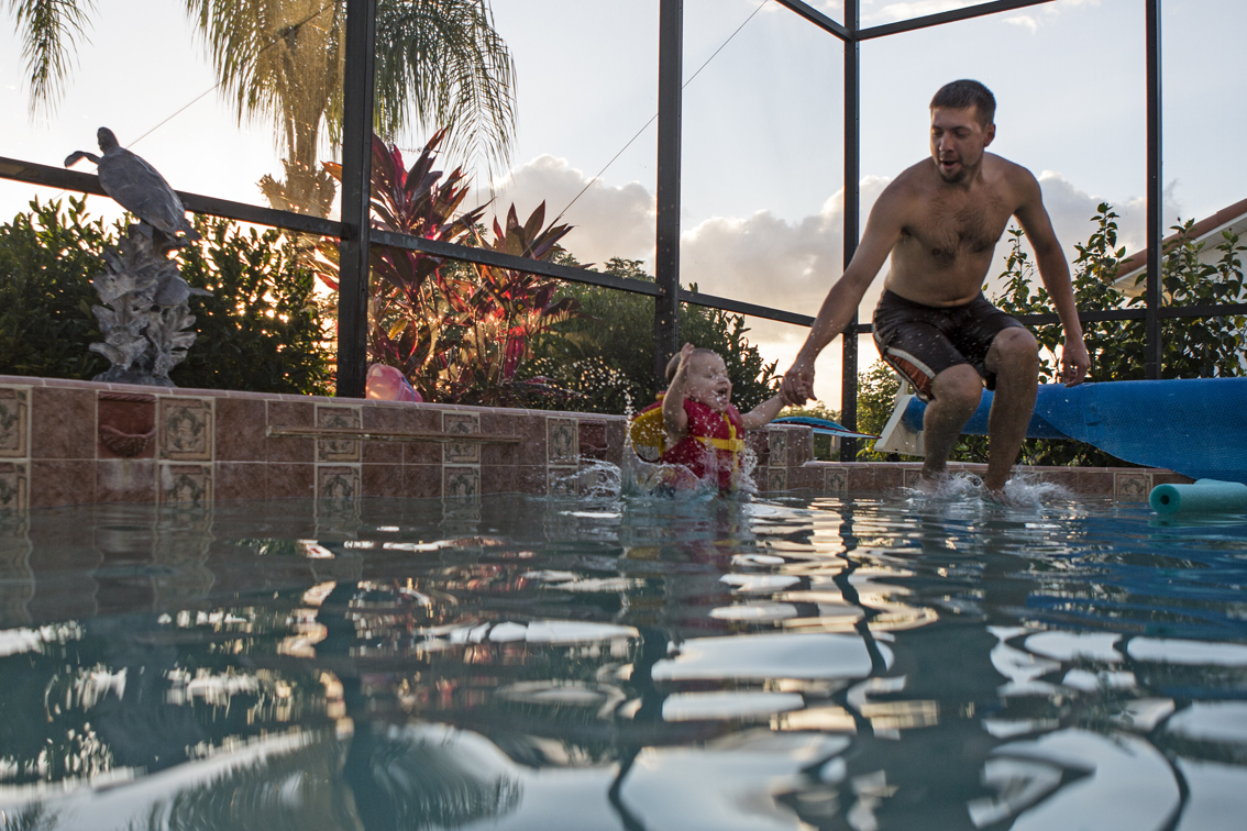 Brenna and Jim doing cannonballs.