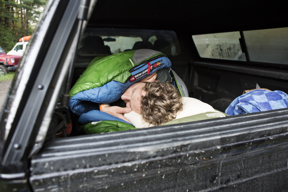 Nate Blick cozied up in the bed of his truck. I rudely woke him up shortly after this.