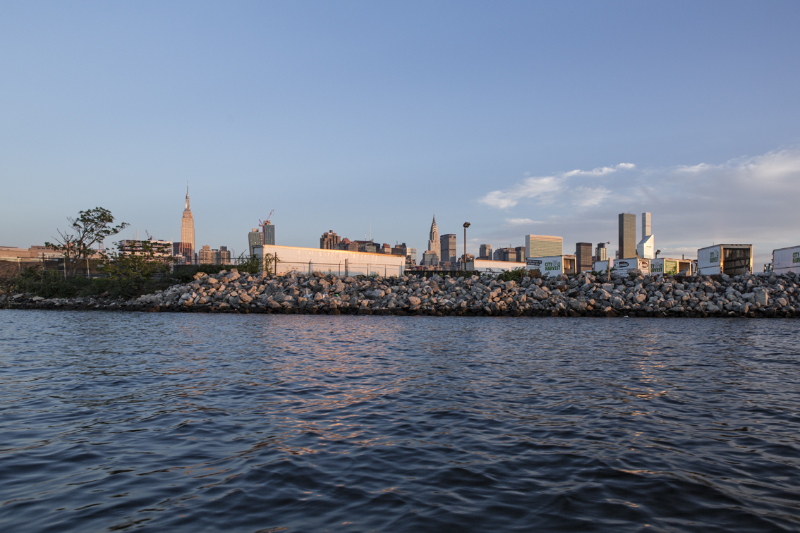 The Empire State building from the water on Newtown Creek.