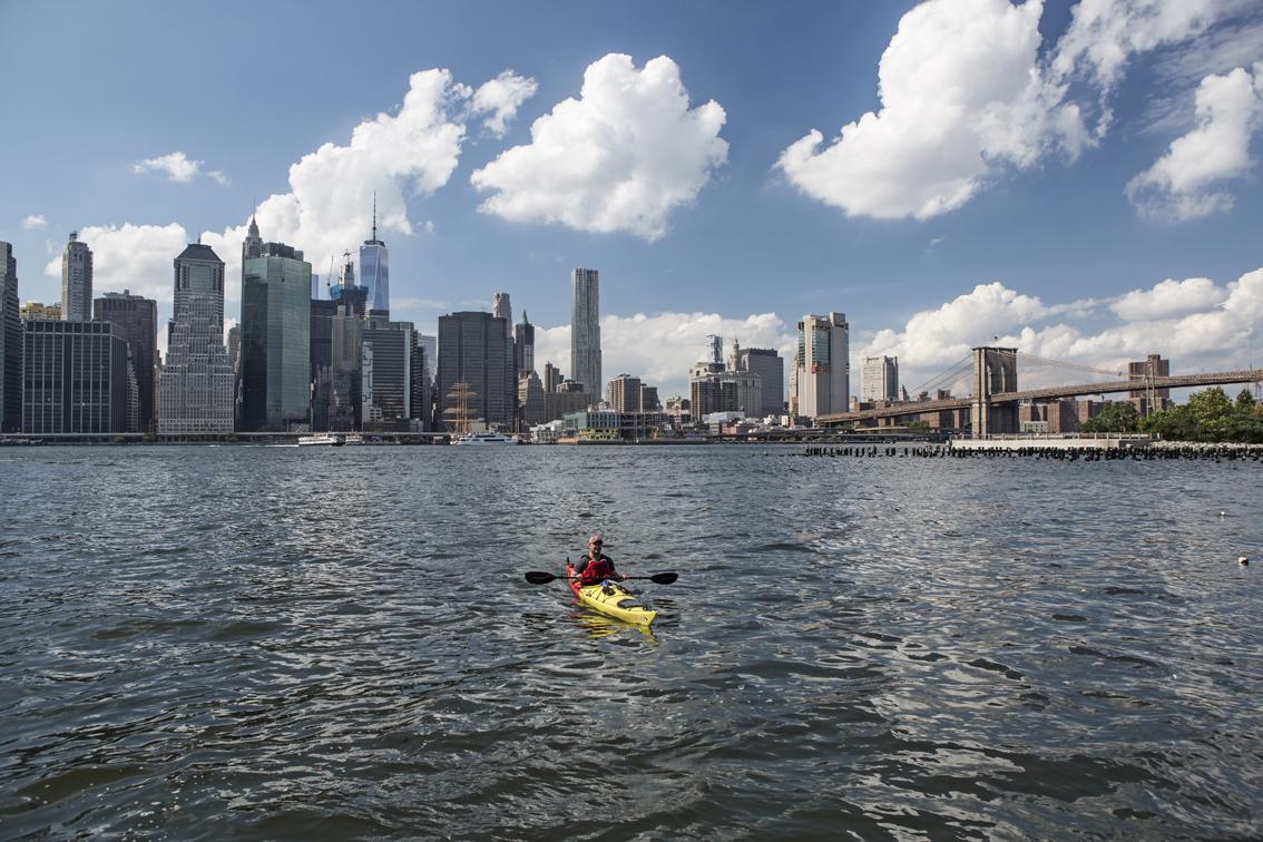 Loren and the Brooklyn Bridge in the background.