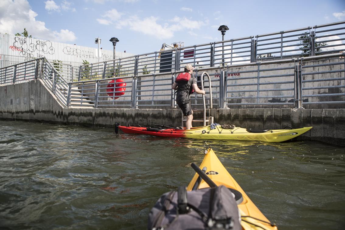 "Loren climbing the ladder at the ""landing"" on Newtown Creek."