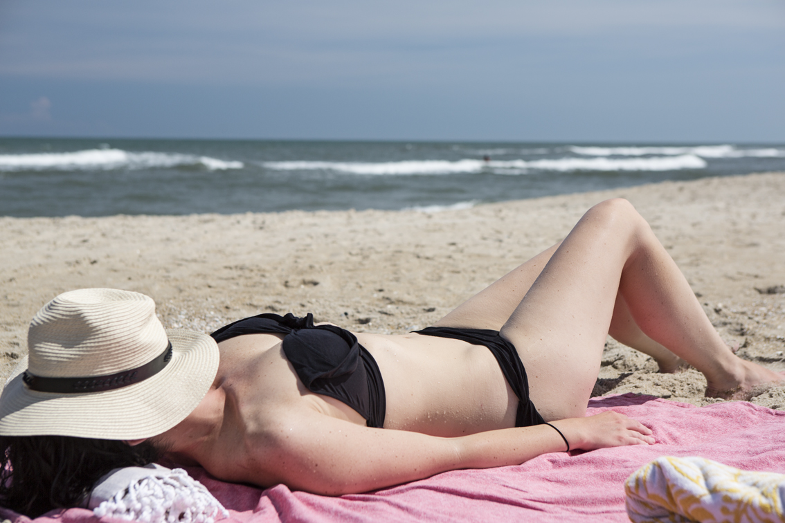 Let the sunburn begin. Sloane on the beach at Chincoteague.