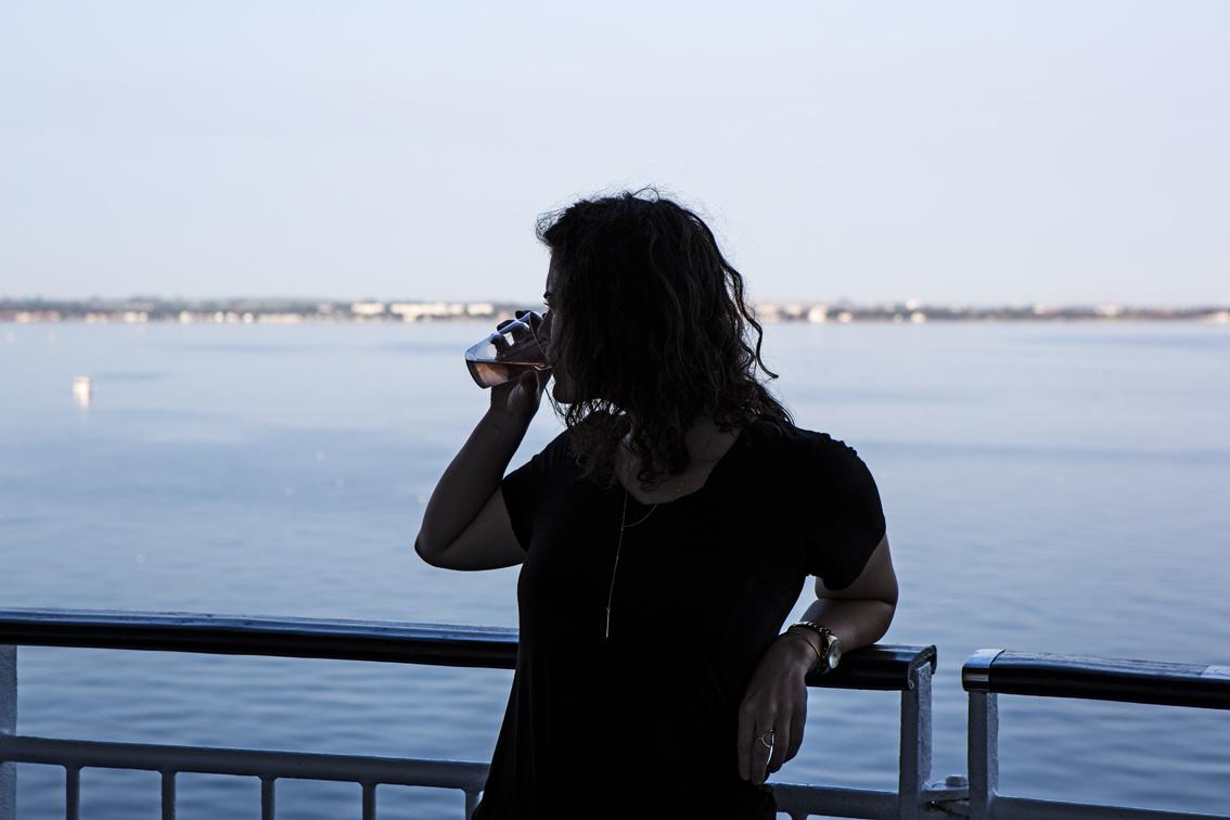 Sloane enjoying some wine while cruising up the Swedish coast.