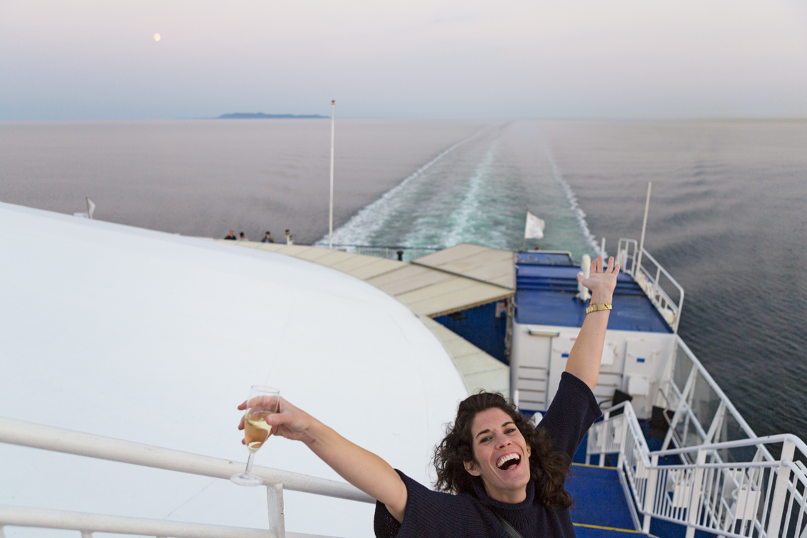 Sloane enjoying the sunset and moonrise on the Crown Seaways.