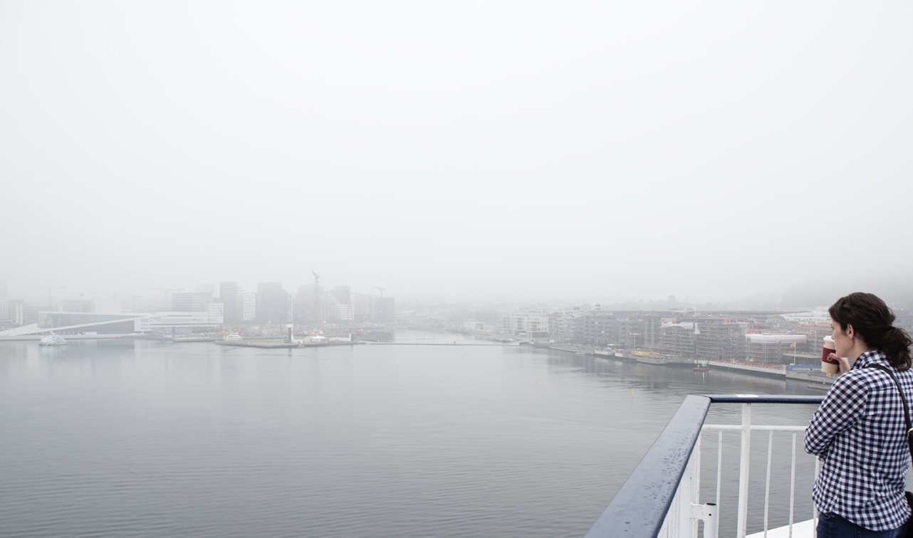 A foggy Oslo view from the top deck of the cruise ship.