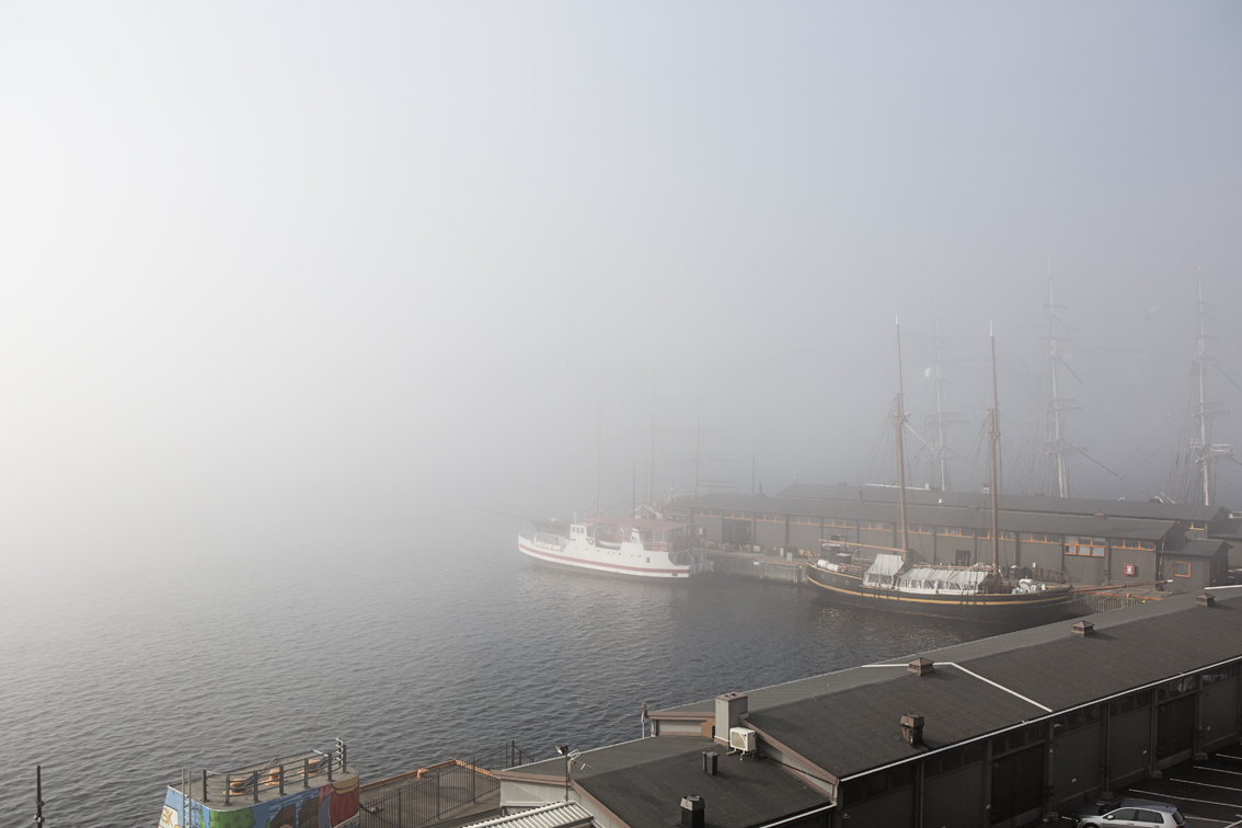 A foggy view of the small harbor from the walls of Akershus.