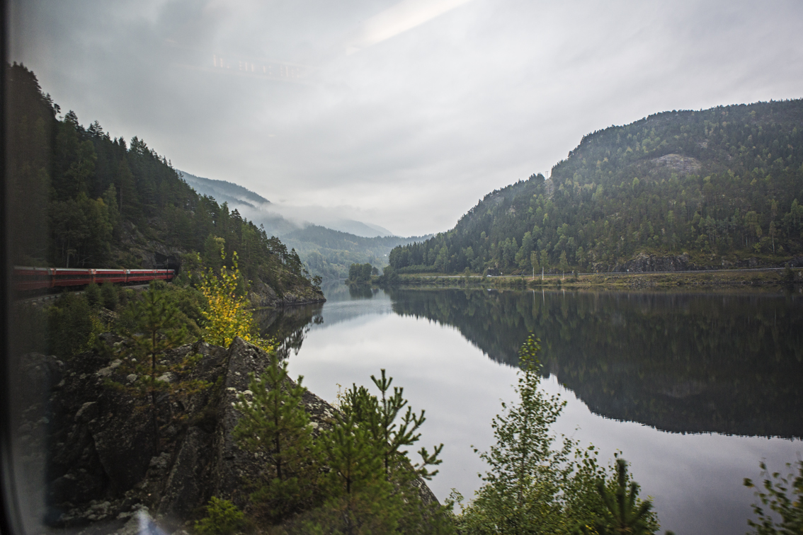Our train coming out of a tunnel, passing a mountain lake en route to Voss.