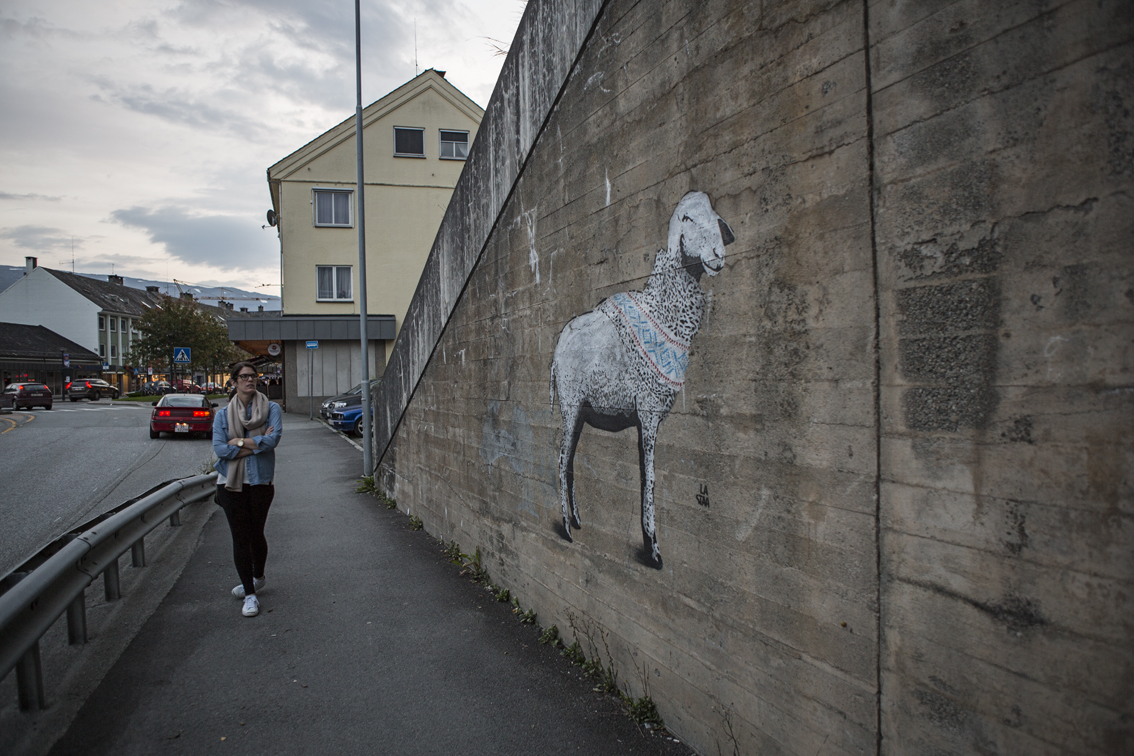 Sloane on the way into town, checking out some Norwegian graffiti.