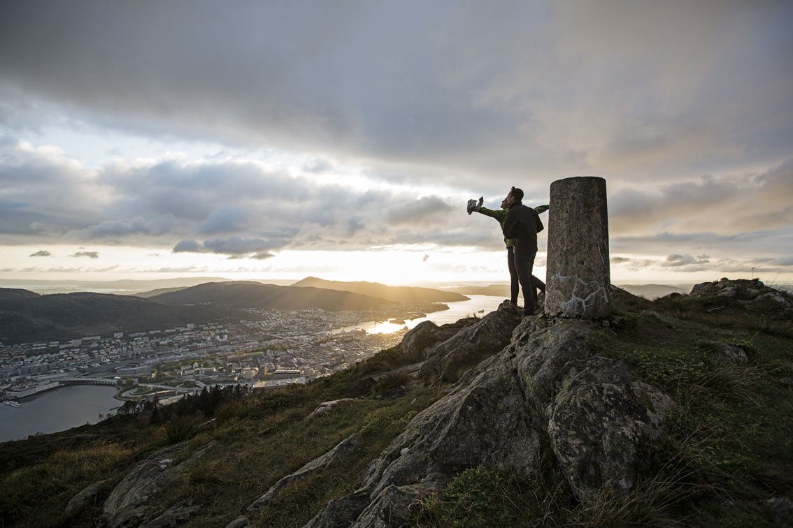 """Our best impression of Jack and Rose from """"Titanic"""" - this view, with the light just poking out below the cloud layer was incredible. Below is Bergen, and beyond is the North Sea."""