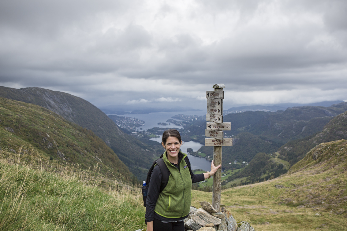 Sloane by one of the signposts marking the way. in the valley below is the town of Ervik, just outside of Bergen, and beyond that is the North Sea.