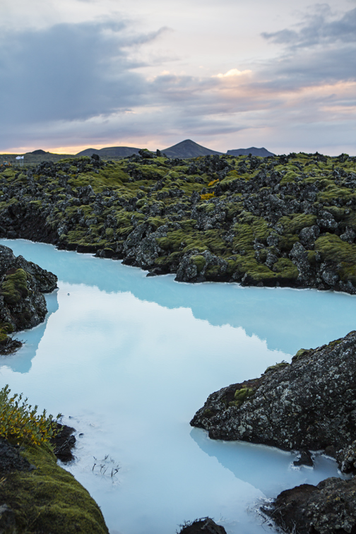 Blue lagoon water and epic iceland backdrop.