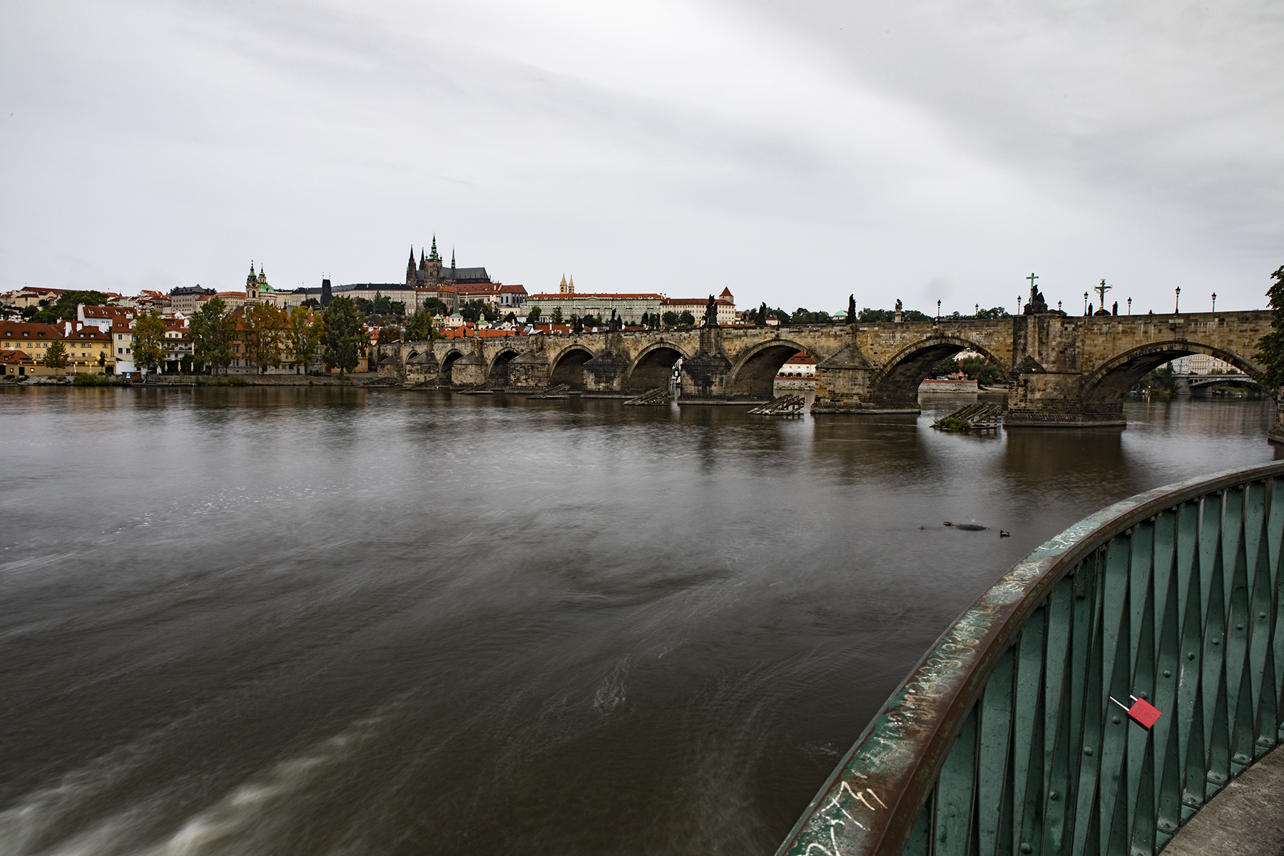 Vltava river and the Charles Bridge. Directly to my right were 20 Asian tourists.