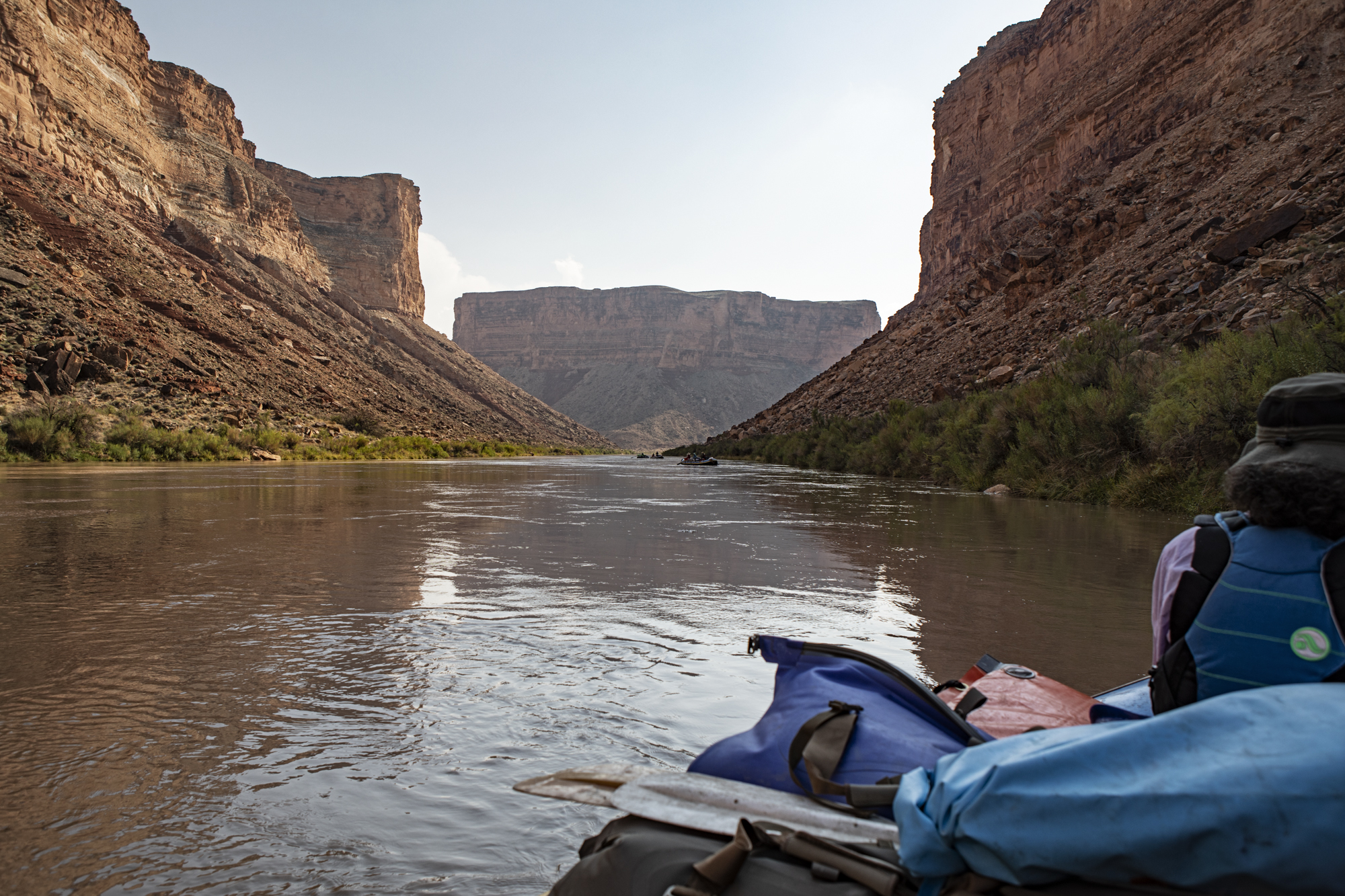 A view downriver, just above our first camp at Soap Creek Rapid. Pat sitting in the bow.