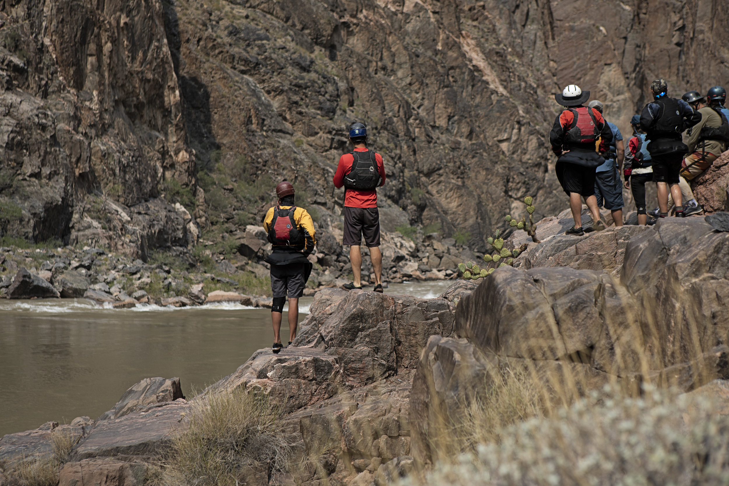 The Astral adorned crew, contemplating their lines through Horn Creek Rapid.