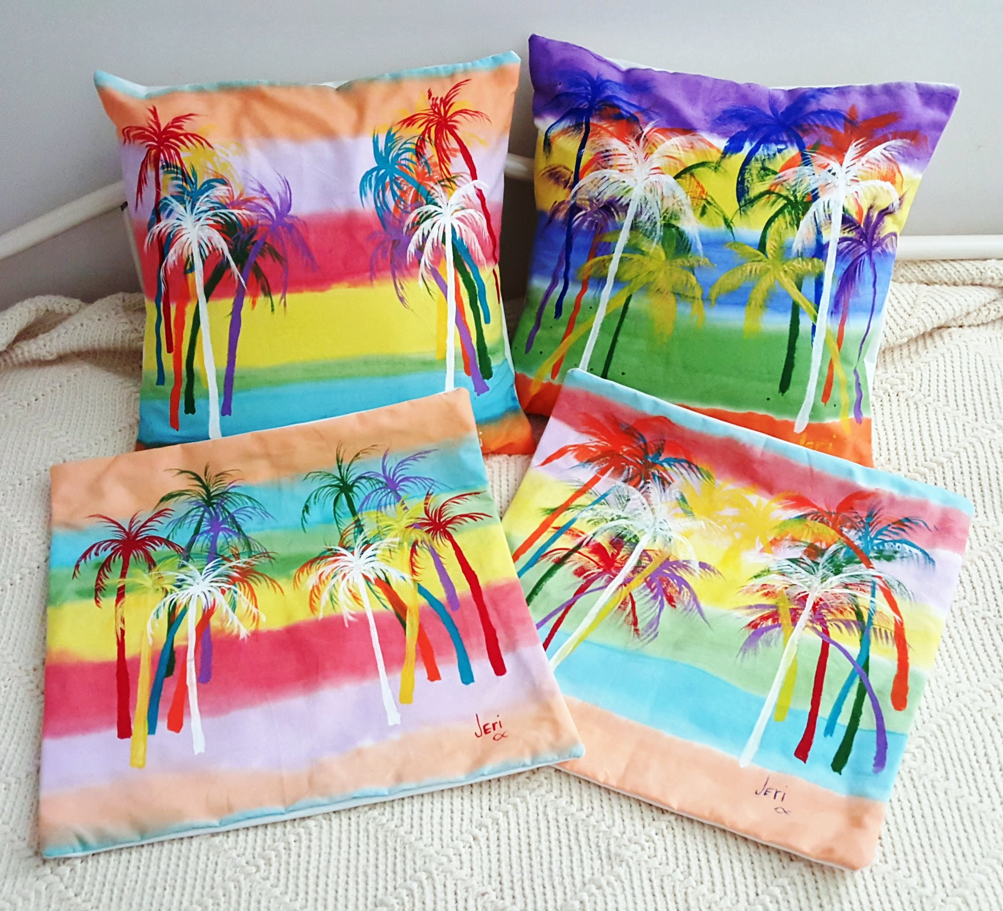 Look what mom-in-law makes: pocket style pillow covers, hand sewn and painted. Unique, no two will be exactly alike.Just insert your existing pillow and your done! A typical 16 inch cover sells for $15 plus shipping, prices for special orders or sizes on request. (Some of her fish and flower pillows are pretty cool too!)