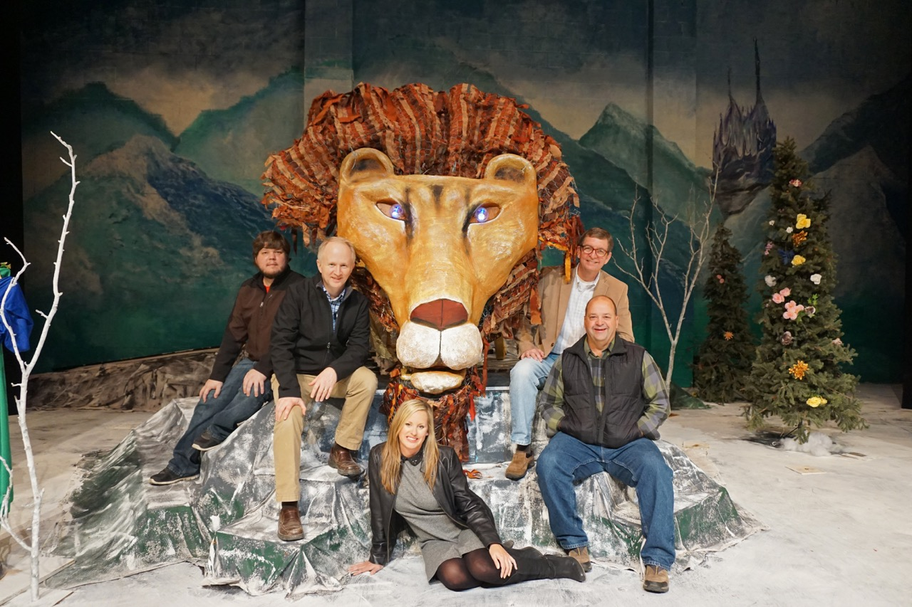 The designers of Aslan and  The Lion, the Witch, and the Wardrobe  set. L–R: Jonathan Freese, Eddy Efaw, Jennifer Aycock, Paul Hayes (sitting), Jeff Frizzell (behind Paul). Not pictured: Stacey Smith