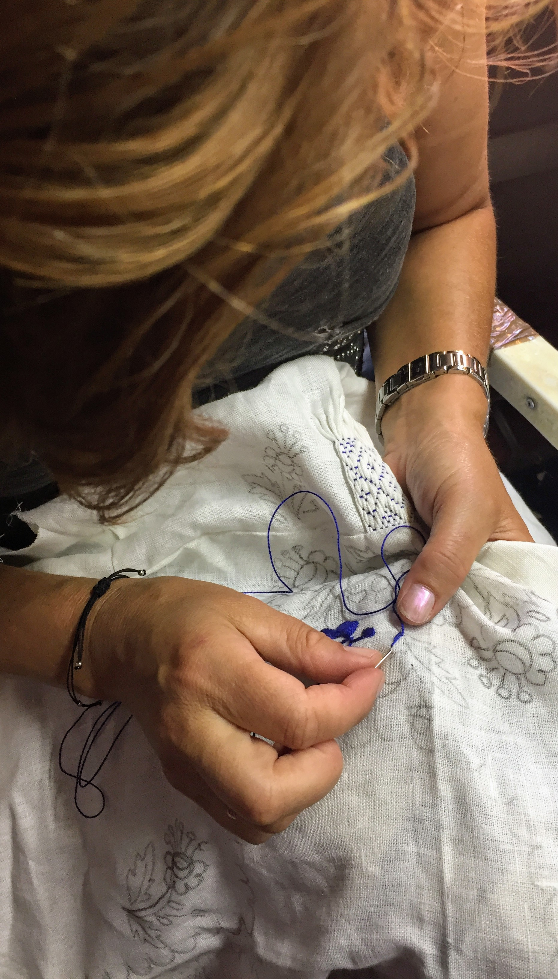 Embroiderer at work on a traditional blouse near Viana do Castelo.