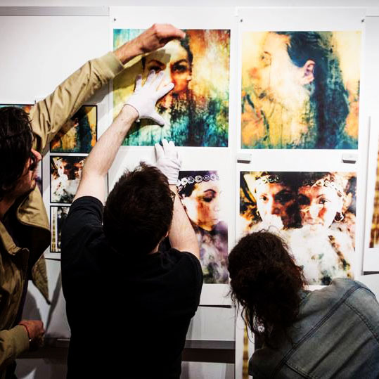 Classmate Vicente and mentor Tom helping me hang my prints for the final crit © 2013 Katrin Eismann