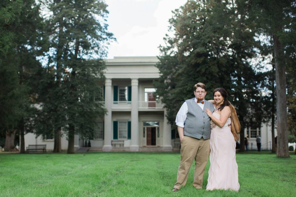 Trey and his wife Sarah posing in front of The Hermitage Mansion.
