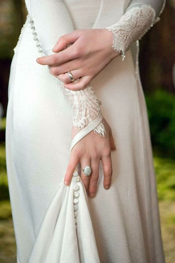 http://www.weddingpartyapp.com/blog/2012/11/20/wedding-dress-with-sleeves-lace-gown-bridal-sleeved-dresses/