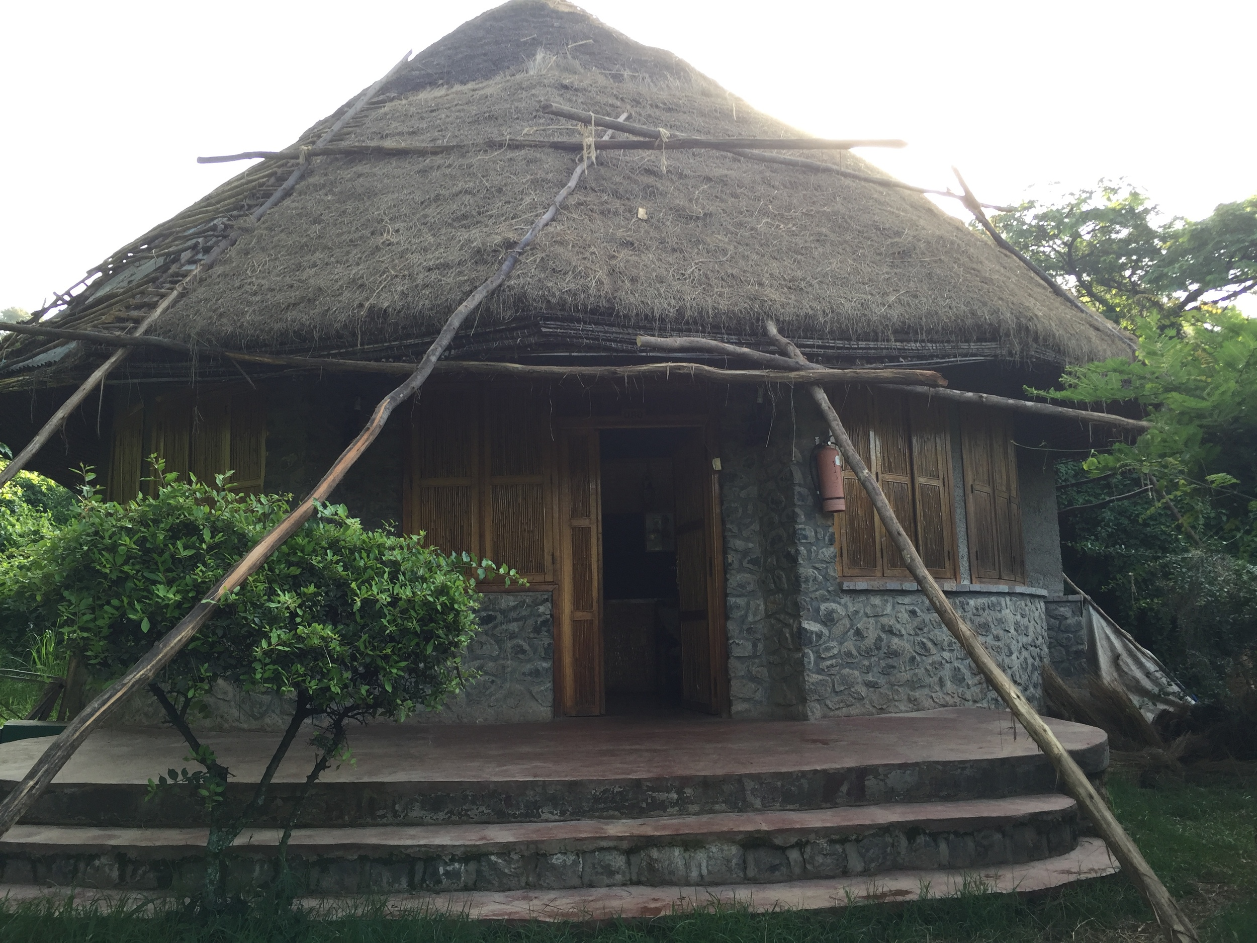 """This was a """"hotel room"""" that we stayed in. It was a large hut, and there were wild monkeys crawling all around it!"""