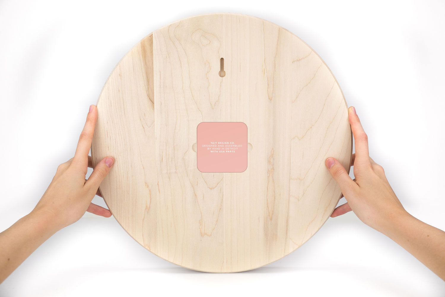 THE BACK - –MAGNETIC STEEL PANEL–Most clocks lack a back cover, leaving the movement and battery exposed. Ours features a back panel that is made from 100% American-made steel and attaches via magnets to protect the movement within.Just like the front dial, the back panel features a hand-pulled two-color screen print.